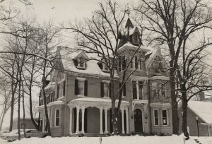 Image of Alpha Chi Rho house covered in snow
